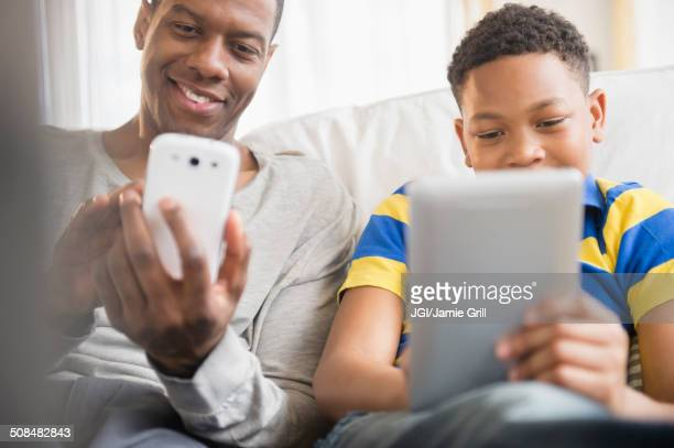 Father and son using technology together