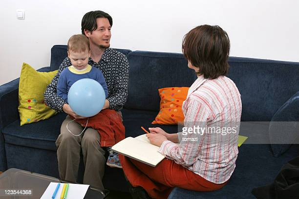 Father and son visit a social worker