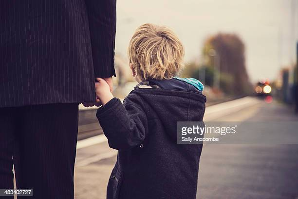 father and son waiting for a train - single father stock pictures, royalty-free photos & images