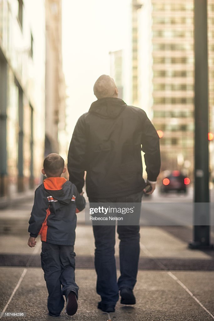Father and son walking down the streets of Chicago : Stock Photo