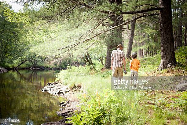 Father and son walking in forest