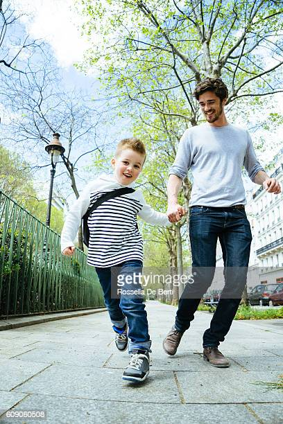 Father And Son Walking Through The Park, Going To School
