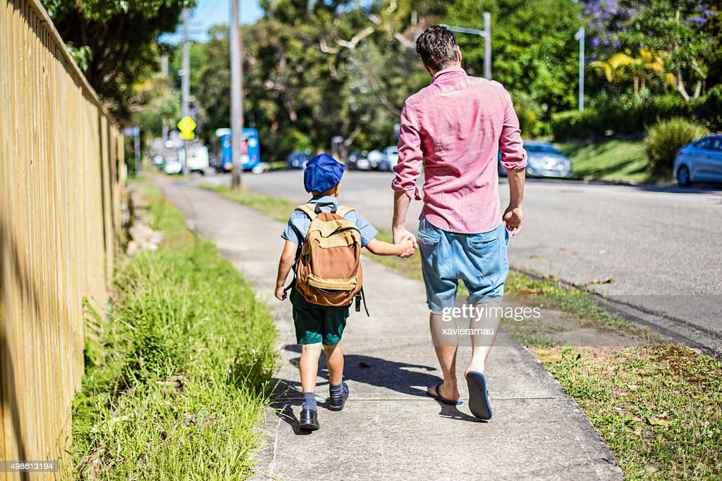Father and son walking to school : Stock Photo