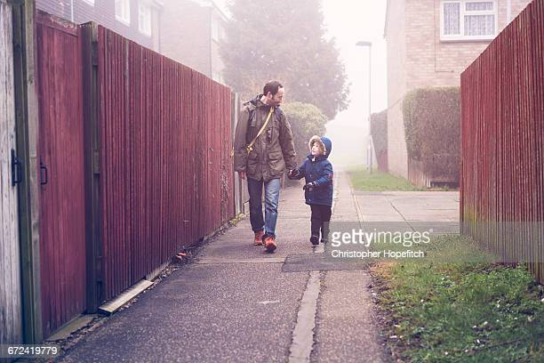 father and son walking to school - one parent stock pictures, royalty-free photos & images