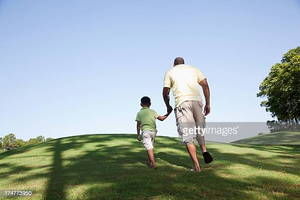 Father and son walking up hill