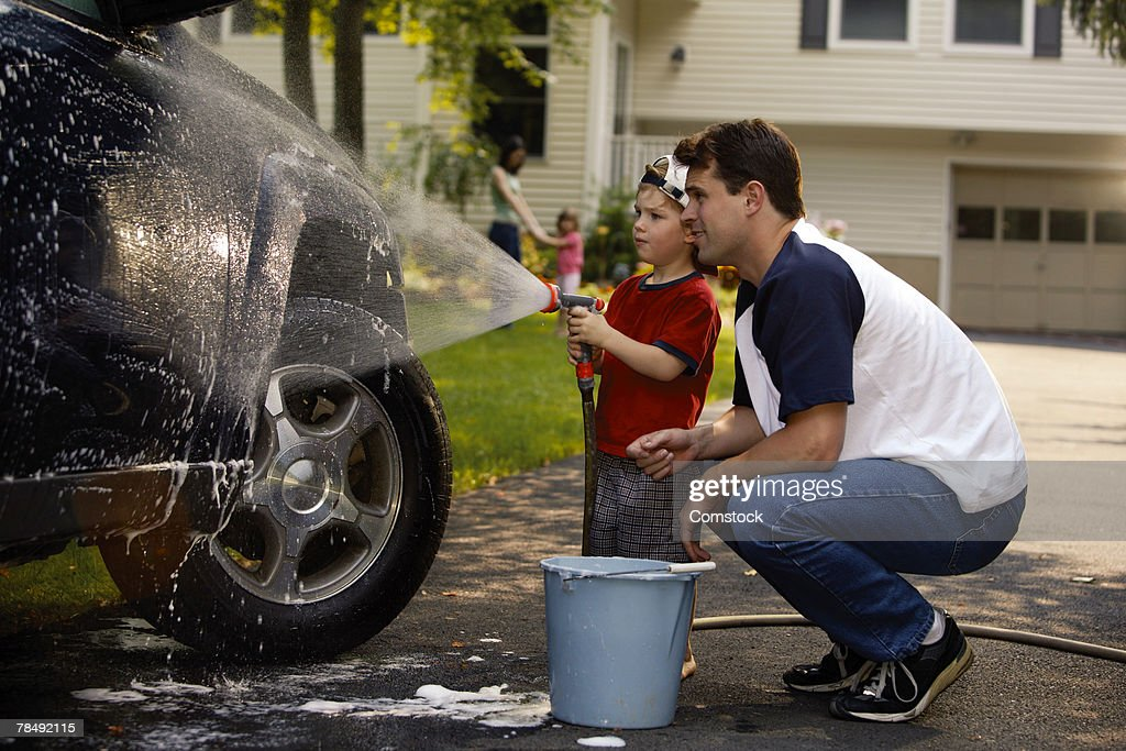 Father and son washing car : Stock Photo