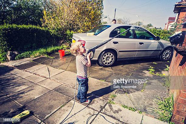Father and son washing the car together