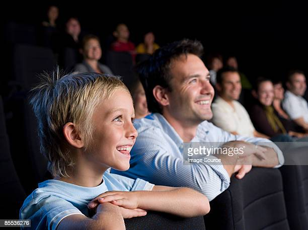 Father and son watching a movie