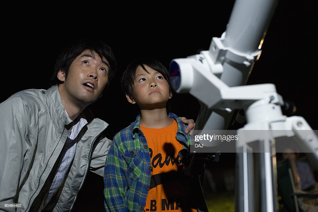 Father and Son Watching Stars : Stock Photo