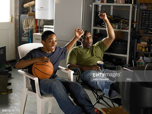 Father and Son watching TV and celebrating