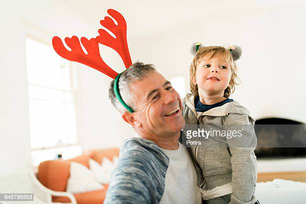 Father and son wearing headbands during Christmas