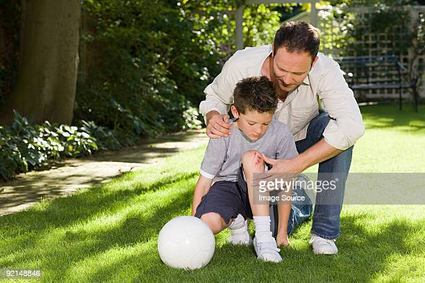 Father and son with a grazed knee