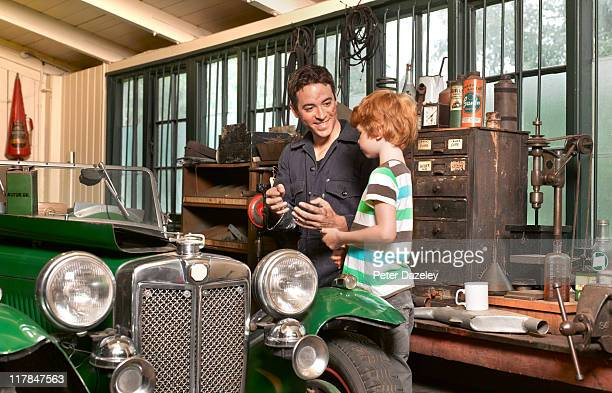 Father and son with classic car