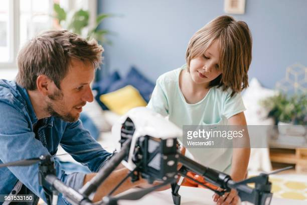 father and son with drone at home - inside helicopter stock pictures, royalty-free photos & images