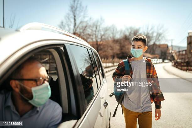 father and son with face protective mask - prevention stock pictures, royalty-free photos & images