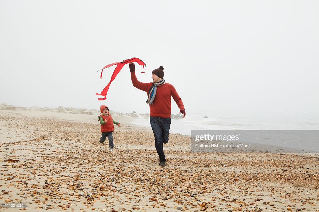 Father and son with kite at the beach : Stock Photo
