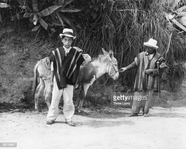 A father and son with their mule in a market in Ecuador