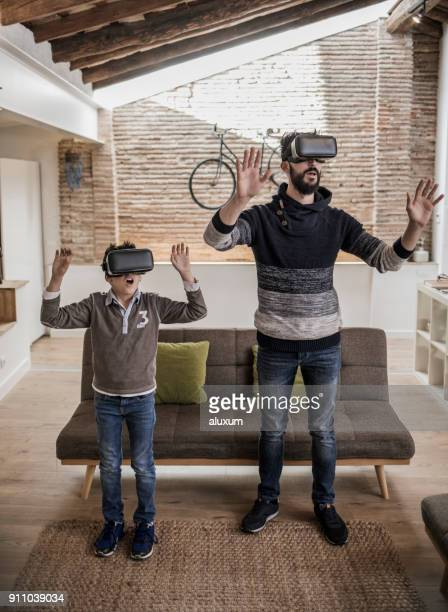 Father and son with virtual glasses in loft