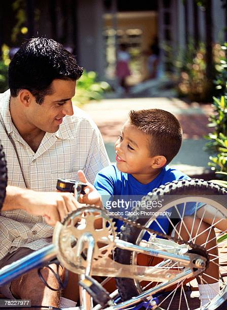 Father and son working on bicycle