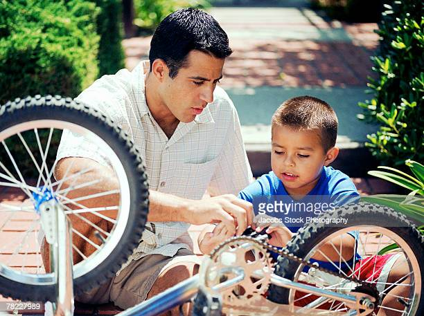 Father and son working on bike
