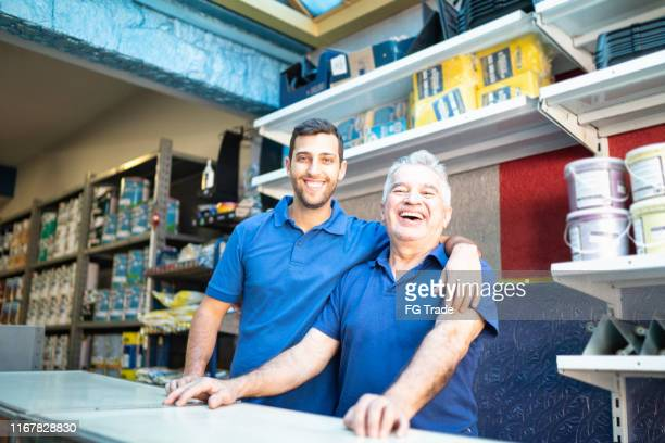 father and son working together in a paint store - two generation family stock pictures, royalty-free photos & images