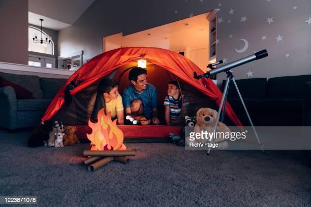 father and sons camping indoors - atividades de fins de semana imagens e fotografias de stock