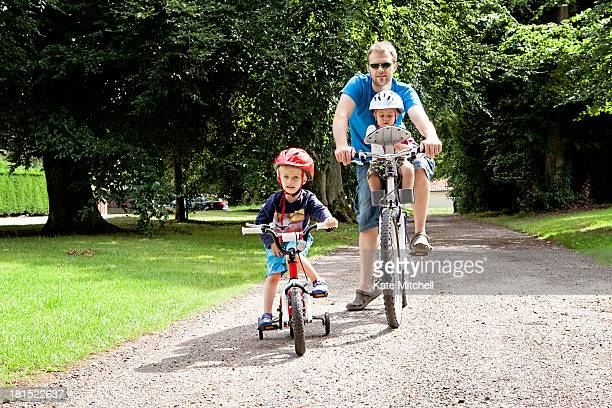 Father and sons enjoying a bike ride together