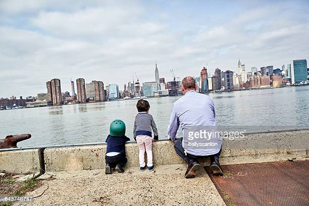 Father And Sons Look At Manhattan.