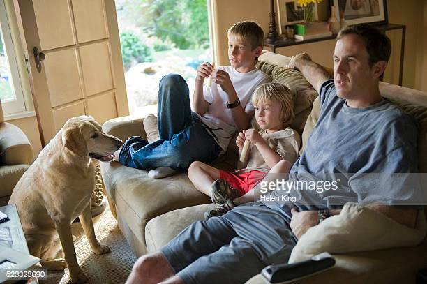 Father and Sons Watching Television
