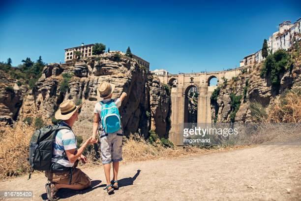Father and sun admiring Puente Nuevo in Ronda, Spain