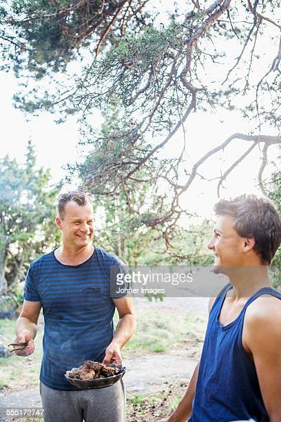 Father and teenage son in garden