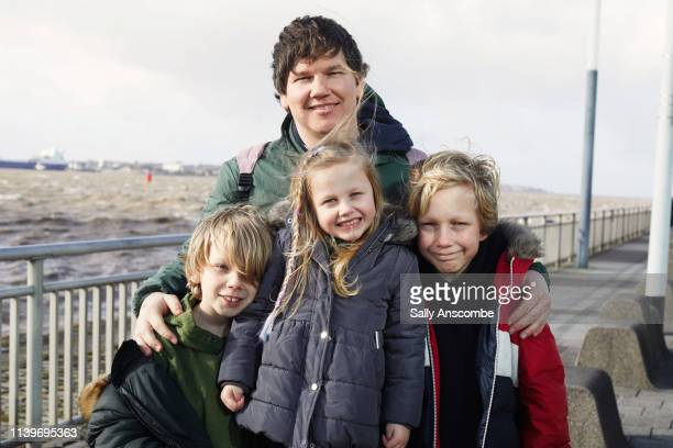 father and three children together - outdoors stock pictures, royalty-free photos & images