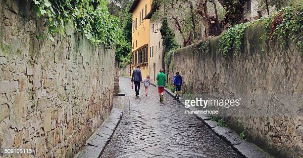 Father and three children walking down street, Florence, Tuscany, Italy