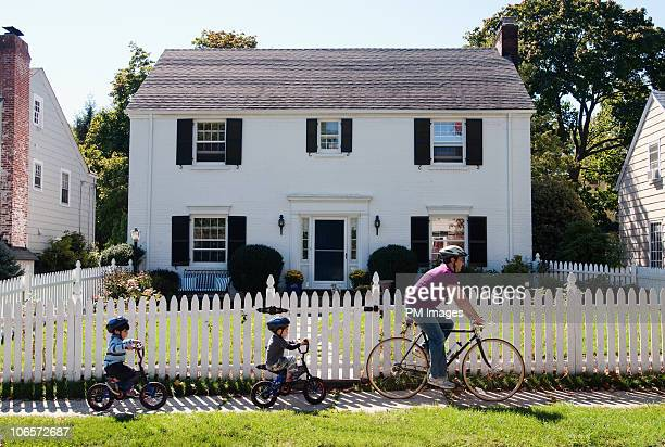 Father and twin sons on bike ride