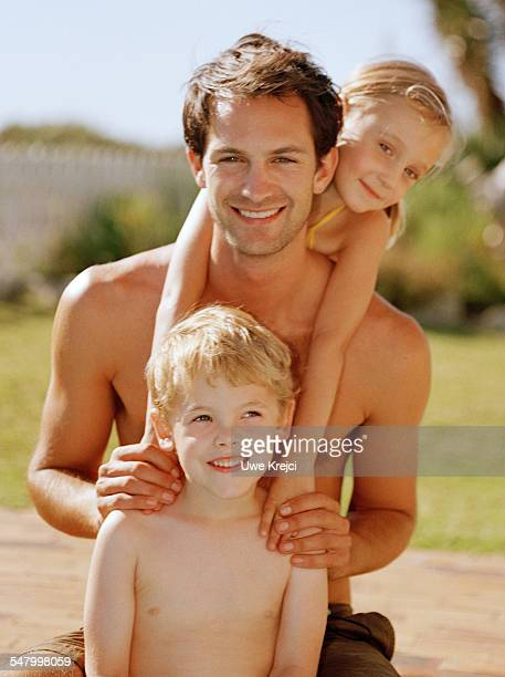 Father and two children outdoors