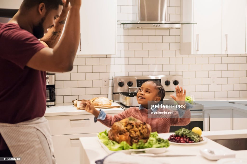 Father and young daughter preparing Thanksgiving dinner. : Stock Photo
