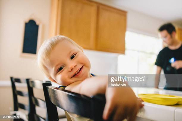 father and young son at home, father preparing food - heshphoto stock pictures, royalty-free photos & images