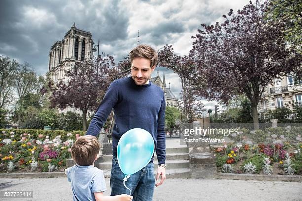 Father and young son near Notre Dame, Paris, France