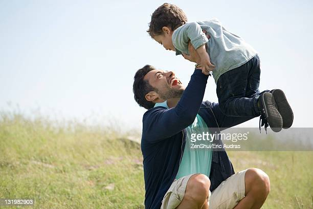 Father and young son playing outdoors