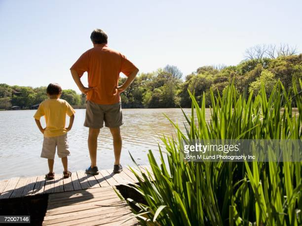 Father and young son standing on dock