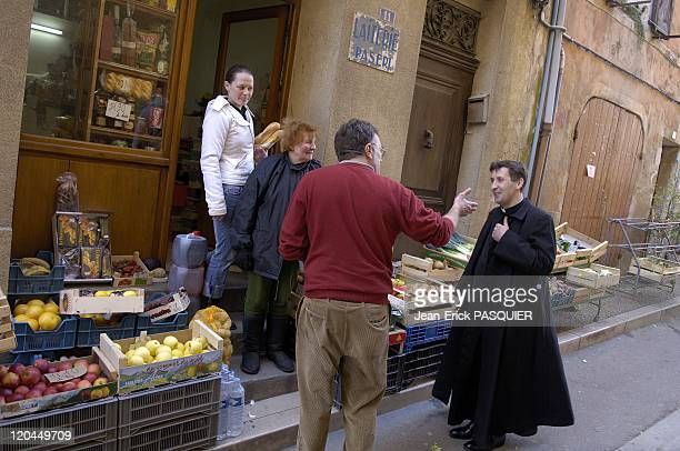 Father Andre A Country The Priest In France Father Andre in conversation with residents and merchants of the village of Rians he exercises his...
