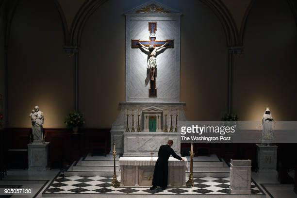 Father Andrew Haissig stands at the altar before people begin to arrive for an evening mass at St Mary Catholic Church on Sunday January 14 2018 in...