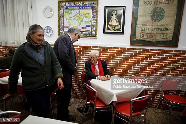 Father Angel speaks to a colleague as a homeless woman pulls her trolley after having a free dinner at Robin Hood restaurant on December 5 2016 in...