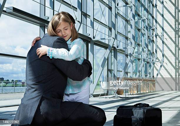 Father arriving in airport with daughter