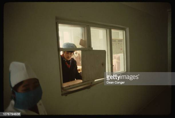 Father at Window to Maternity Ward Mongolia