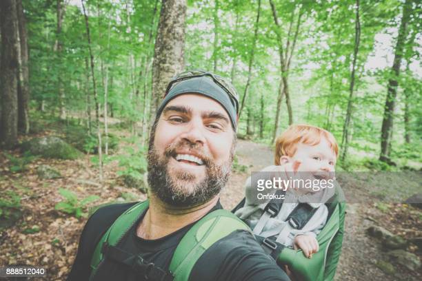 father backpacking hiking with toddler in forest - selfie stock pictures, royalty-free photos & images