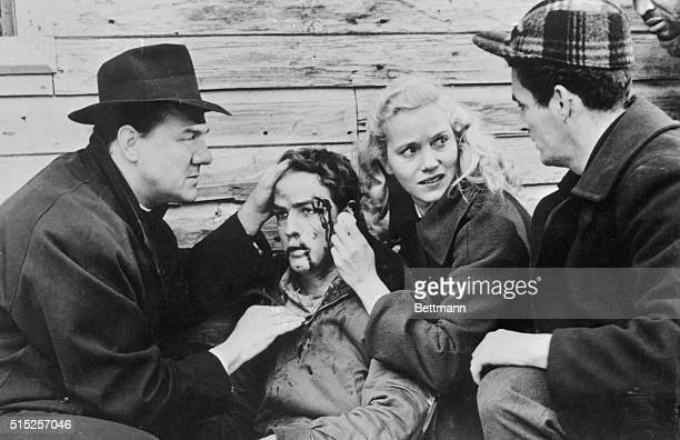 Father Barry realizes that Terry will be all right after a brutal beating by one racketeer waterfront boss as Edie stands by in the 1954 motion...