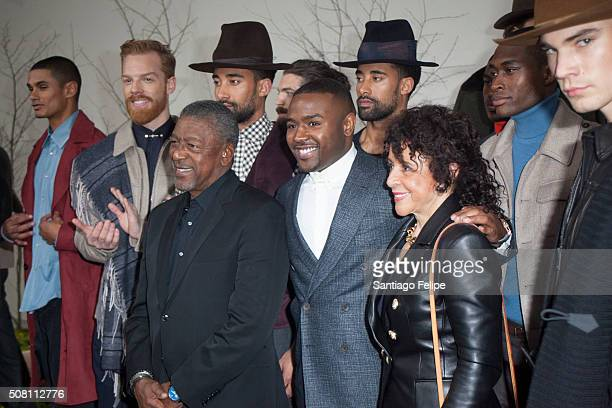 father Bob Johnson designer Brett Johnson and mother Sheila Johnson pose with the models at the Brett Johnson Presentation during New York Fashion...