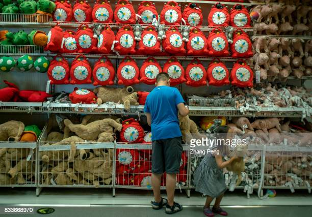 A father buys toys for his daughter in an IKEA shop In 2016 the total sales of IKEA in China reached 125 billion yuan an increase of 189% and...