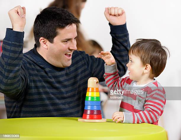Father/ Carer Interacting With Toddler